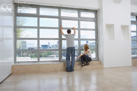 Couple Checking View From New Apartment
